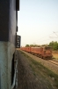 WAM4 21116 rushes past coach D2 of 18008 1250 Baripada - Shalimar near Belda