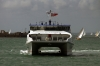 A Wightlink Catamaran arrives after finding a way through the JP Morgan round the Island boat race off the coast of Ryde as the boats near the end at Cowes