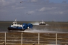 One Hovercraft departs as the other arrives at Ryde
