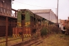 Bombardier MX615's 502, 503 & 500 rust away just inside th gate of Limbe Workshops