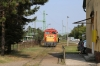 MAV NG Mk48-2013 backs the stock towards the narrow gauge station at Balatonfenyves to work the 1605 Balatonfenyves GV - Somogyszentpal