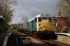 31235 at Thuxton with the 1245 Dereham - Wymondham Abbey; 47579 passes by with a driver experience run