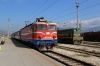 ZCG Cargo 644015 stands in the station at Podgorica, acting as station pilot, while ZCG 461039 stands with 6103 0930 Bijelo Polje - Bar local