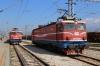 ZCG 461039 stands at Podgorica with 6103 0930 Bijelo Polje - Bar local while ZCG Cargo 461030 runs through the adjacent yard