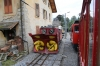 MOB new loco Hem2/2 #11 leads the La Belle Epoque Summer service, 1415 Montreux - Rochers de Naye by Glion shed; on shed stand HGe2/2 #2 and a snowplough