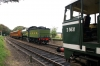 31207 waits at Weybourne with the 1200 Sheringham - Holt, while B12 Steam loco 6572 arrives with the 1200 Holt - Sheringham