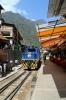 Peru Rail Alco DL532 #353 runs through the street at Aguas Calientes with the empty stock off the Belmond Hiram Bingham Train 11 0905 Cusco Poroy - Machu Picchu