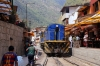 Peru Rail MLW DL535 #481 runs through the street at Aguas Calientes, back up to Machu Picchu, after turning on the wye outside of town