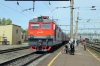 RZD EP1-124 waits time at Magdagachi with 325Sh 1917 (P) Khabarovsk 1 - Neryungi Pas. while TEM18DM-1155 shunts a single wagon in the station yard