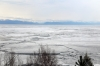 Siberian scenery on the BAM at Severobaikalsk - a frozen Lake Baikal, the largest freshwater lake in the world - seen from 075E 0457 Neryungri Pas. - Moskva Kazanskaya