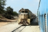 Societe d'Exploitation Ferroviaire des ICS (SEFICS) GM CC2463 runs through the Pikine area with a Dakar bound freight