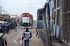 Ex IR YDM4 CC1504 (6496) departs Thiaroye with 331 1630 Dakar Cyrnos - Rufisque as TiZir Ltd NRE Genset RS-CC-02 approaches with a freight
