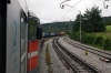 SZ 664104 heads MV482 1155 Rijeka - Ljubljana away from Prestranek to drag the train to Borovnica