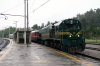 SZ 664118 departs Rakek in the pouring rain while it drags MV483 1505 Ljubljana - Rijeka to Prestranek