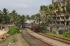 SLR Class M4 (MLW MX620) approaches Mount Lavinia with 8749 1430 Colombo Maradana - Panadura; with Colombo visible along the beach