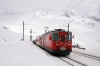 MGB Deh4/4 I # 21 waits at Natschen for trains to cross it, with the 1150 Sedrun - Andermatt Autozuge train