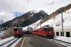 Sagliains (L-R) - RhB Ge4/4 II #624 about to depart with 1933 1134 Scuol-Tarasp - Pontersina & RhB Ge4/4 II #631 about to depart with RE1233 0844 Disentis - Scuol-Tarasp