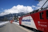 RhB Ge4/4 II #618 waits at Klosters Platz with RE1236 1140 Scuol-Tarasp - Disentis for RhB Ge4/4 III #649 to arrive with RE1037 1147 Landquart - Davos Platz