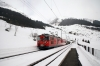 MGB Deh4/4 I #21 runs through Dieni with the 1150 Sedrun - Andermatt car train
