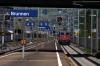 SBB Re4/4 11204 arrives into Brunnen with IR2275 1409 Zurich HB - Locarno