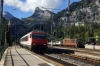 SBB 460049 runs through Kandersteg while BLS Re425 162 waits with a car train for Goppenstein