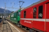 RhB Ge4/4 III 647 departs Domat/Ems with RE1121 0758 Chur - St Moritz