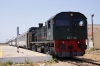 DK89 waits in the blistering sunshine to cross another train at Sidi S'mail with 14 1150 Ghardimaou - Tunis