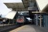 Caltrain F40PH-2 #913 departs Millbrae with 427 1000 San Jose Diridon - San Francisco
