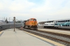 BNSF GE AC4400CW 5668 (with EMD F59PHI #877 on the rear) arrives into LA Union with 116 1419 Moorpark - LA Union while Metrolink MPI MP36PH-3C #890 waits to depart with 318 1556 LA Union - San Bernadino