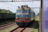 UZ VL10-1313 runs by its train at Mostyka 2 before working 052 0823 Przemsyl Glowny - Lviv forward to destination