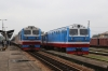 DSVN D19E-901 waits at Vinh with SE36 1230 Vinh - Hanoi while D19E-910 arrives with SE8 0600 (P) Saigon - Hanoi